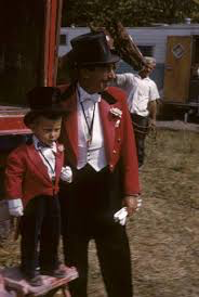 """Angelo Nicholas (better known as """"Count Nicholas""""), was born Aug. 31, 1910, in Volos, Greece. Angelo became one of the most famous circus ringmasters in America. As a youth Nicholas Emigrated to the United States. In 1927 at age 16 Nicholas joined the Ringling Brothers and Barnum & Bailey Circus in Bridgeport, Connecticut. Nicholas' first job on the circus was as a usher, seating audiences as they came into the big top. Circus Ringmaster Fred Bradna, who had been with RBBB since 1919, took a liking to the youth. Bradna was idealized by the young Nicholas and soon became his mentor. Nicholas was with the RBBB during the tragic Hartford Fire in 1944. In 1951 Count Nicholas became the ringmaster of the Ringling Brothers and Barnum & Bailey Circus and continued in that position until 1955. on August 31 1954 (His 44 birthday) """"the Count"""" was presented with a gold whistle by fellow performers. After leaving Ringling, Count Nicholas served as ringmaster on many large circuses, including the Clyde Beatty Cole Bros. Circus. In 1967 Nicholas was hired by the James E. Strates Shows (a large railroad carnival), as their Ambassador of good will. In this position the Count met with the press, gave interviews and promoted the rich history of the show which had started as a small carnival in 1910. Count Nicholas died on Jun. 20, 2001, at age 90."""